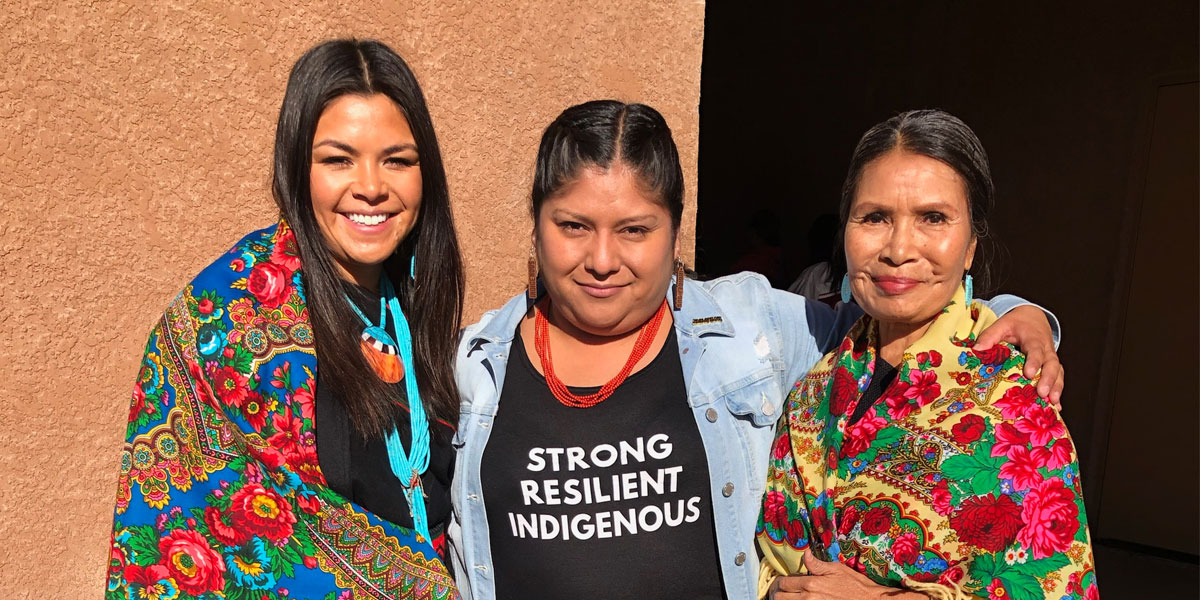 Mayane (at left) celebrating Indigenous Peoples' Day in New Mexico with Tribal community members