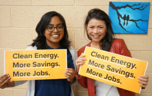 Melanie and Lavannya holding signs