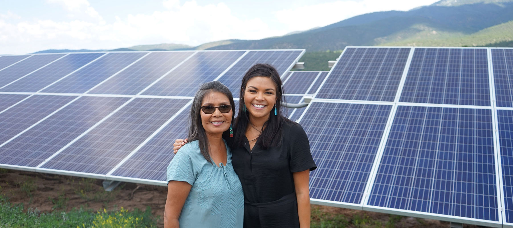 Mayane at right with Ann Barudin, touring Picuris Pueblo's 1MW solar array