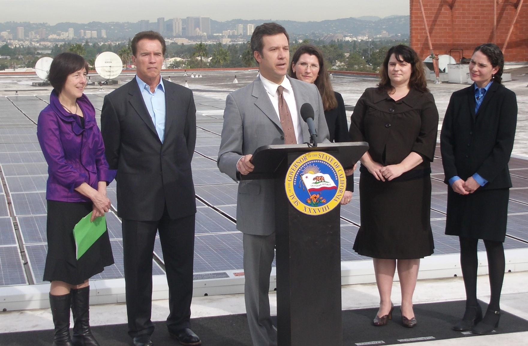 Adam with Nancy Skinner, Gov. Arnold Schwarzenegger, Julie Blunden, Sara Birmingham and Bernadette del Chiaro at the signing of AB 510 in 2010, which raised the net metering cap in California