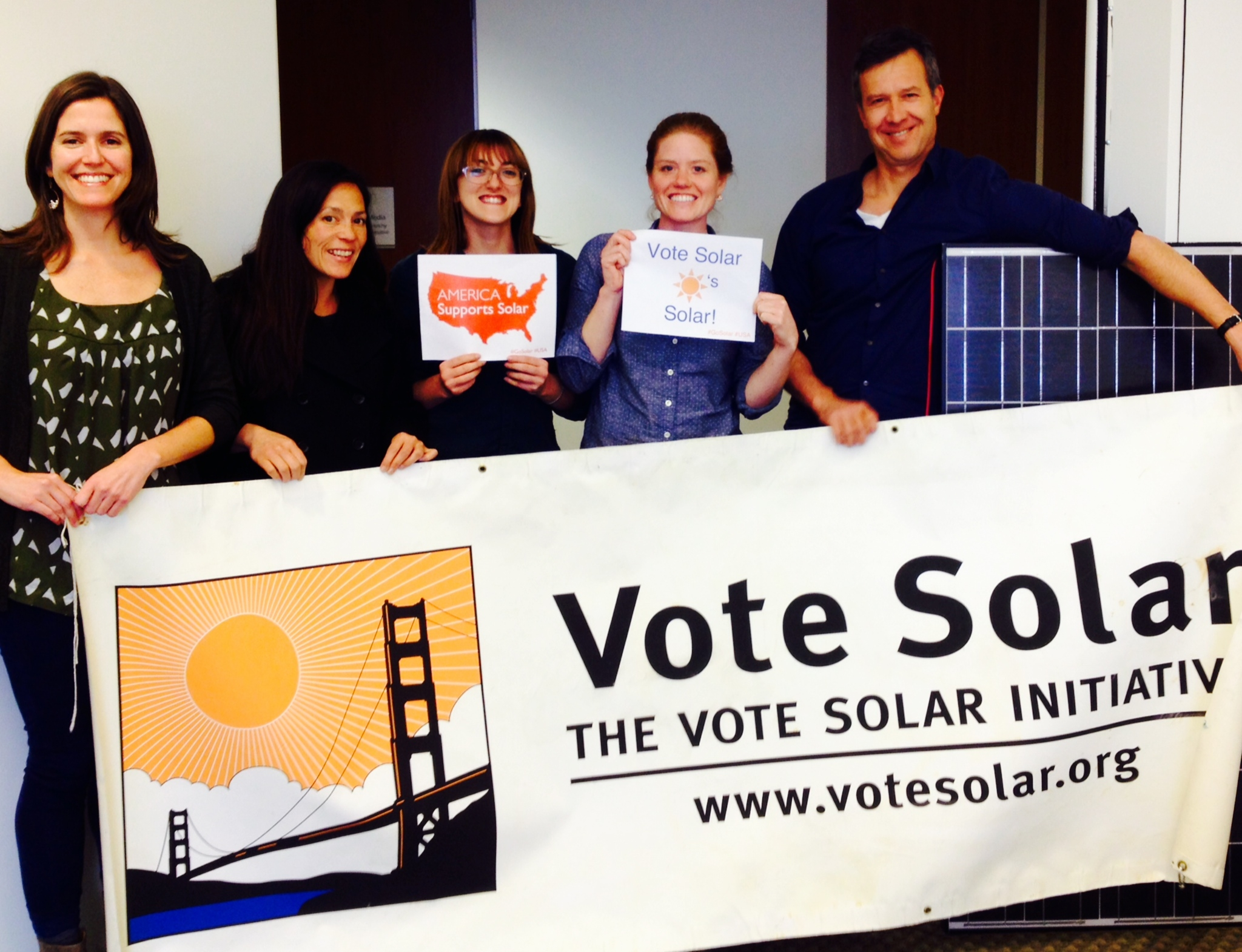 Adam with the growing Vote Solar team in 2014