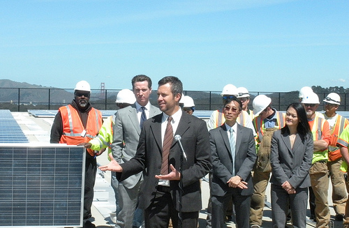 Adam at the Sunset Reservoir solar installation in 2010, one of the largest municipal solar arrays installed at the time in the U.S., with then-Mayor of San Francisco Gavin Newsom attending.